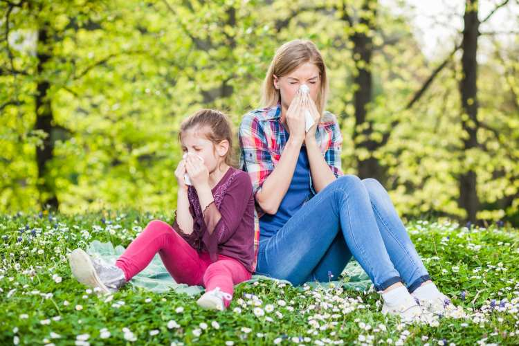 Allergic reaction - mom and daughter on a meadow