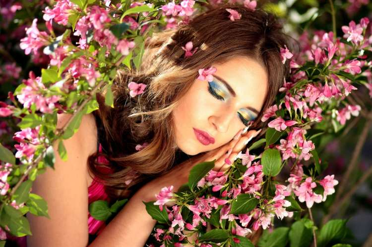 Girl sleeping in pink flowers
