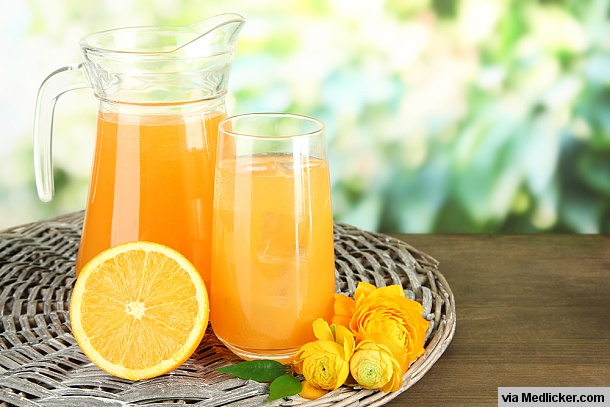 Glass and Pitcher full of orange juice