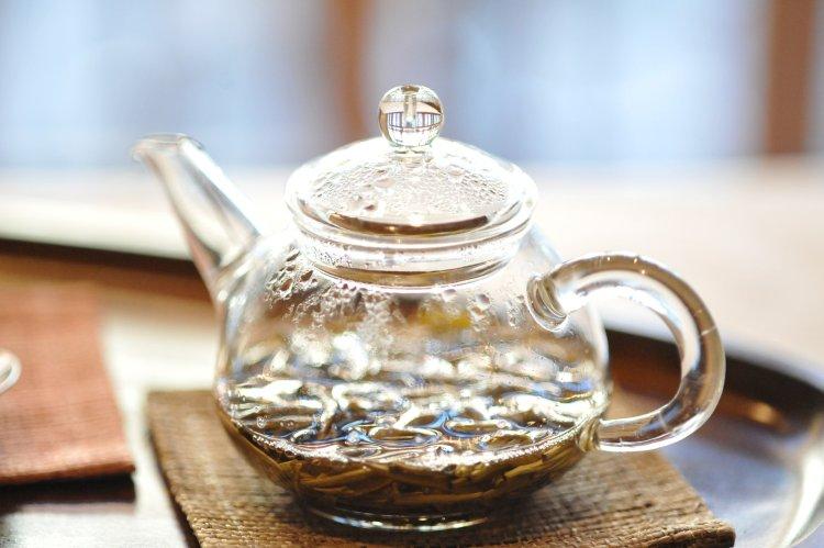 Jasmine tea in glass kettle